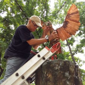 Sculptor Ral Arrogante installs the dove.